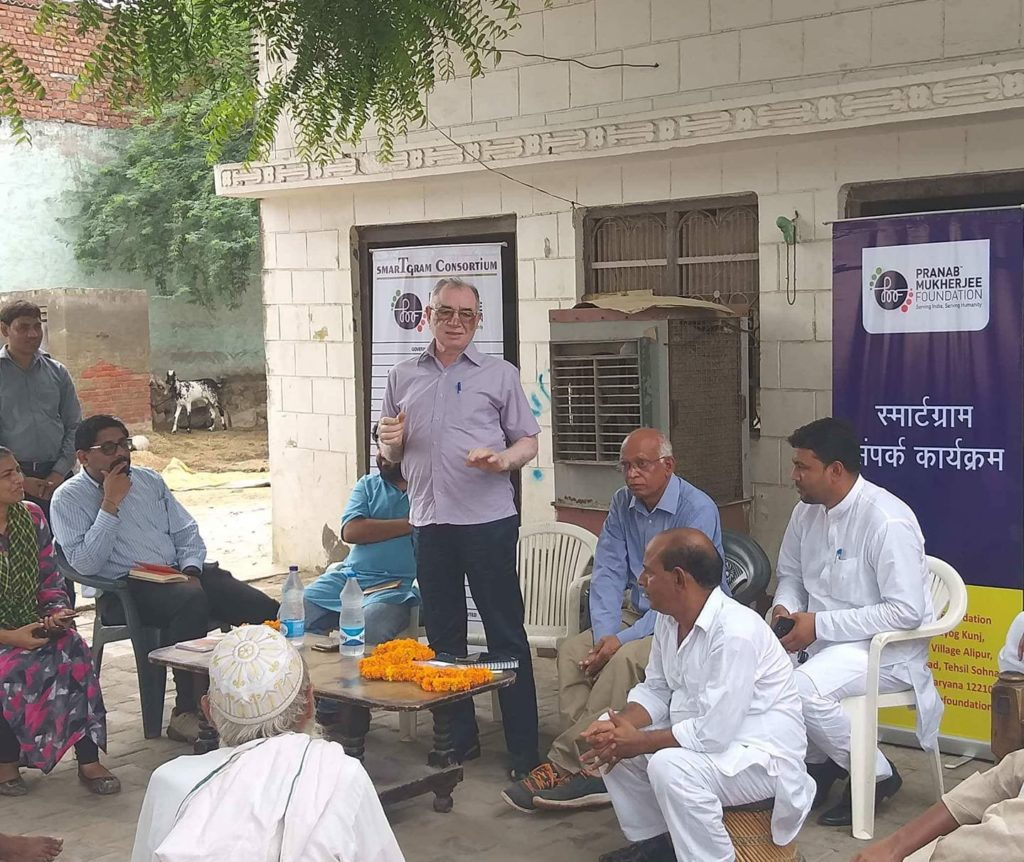 Meeting villagers on the introduction of e- Rikshaw