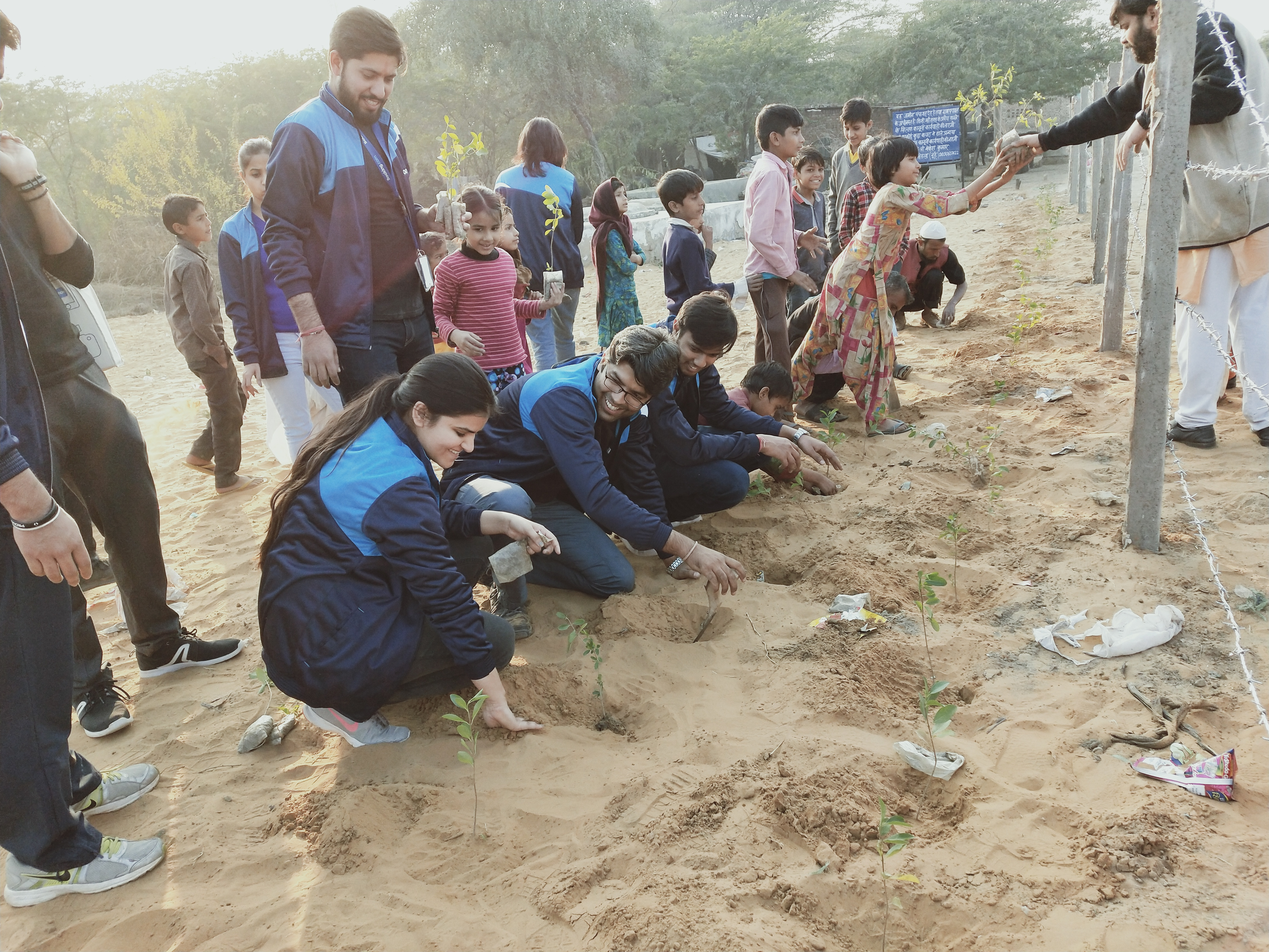 Plantation with villagers to convert garbage dumping ground into a green space